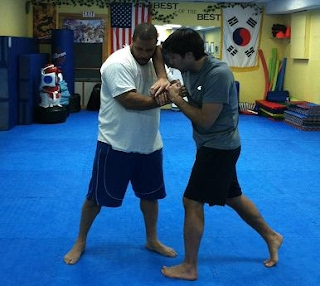 Elbow strikes drill in MMA Fight Training Class at BartmanMMA