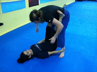 Double Ankle Grab Sweep in Women's KickAss Self-Defense Class