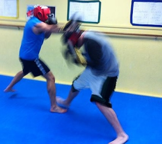 MMA Fight Training Class Sparring with gloves and head gear
