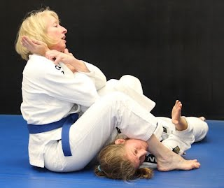 women's self defense arm lock with Bartman MMA and Self-Defense, Relson Gracie Association  near Rockville, Silver Spring and Bethesda, Maryland
