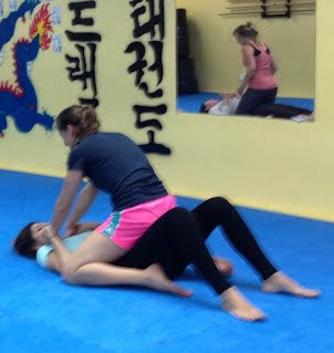 Bottom Mount defense in Women's Self-Defense Workshop Class at Bartman MMA in Silver Spring and Bethesda, MD, A Relson Gracie Jiu-jitsu Association