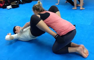 Defending one of the worst case scenario in Women's Self-Defense Workshop class at Bartman MMA in Silver Spring and Bethsda MD, a Relson Gracie Jiu-jitsu Association