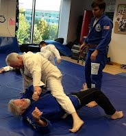 Jack and Mike training under Relson Gracie Blackbelt Greg Bartman at the Bethesda location of Bartman MMA and Self-defense