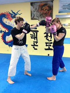 Punch blocks with gloves in MMA Fight Training Class at BartmanMMA