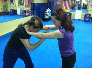 Two-hand throat grab bow out escape, Women's Self-Defense Workshop Class in near Washington, DC, Bethesda, Silver Spring, Wheaton and Rockville